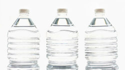 Three plastic bottles with water